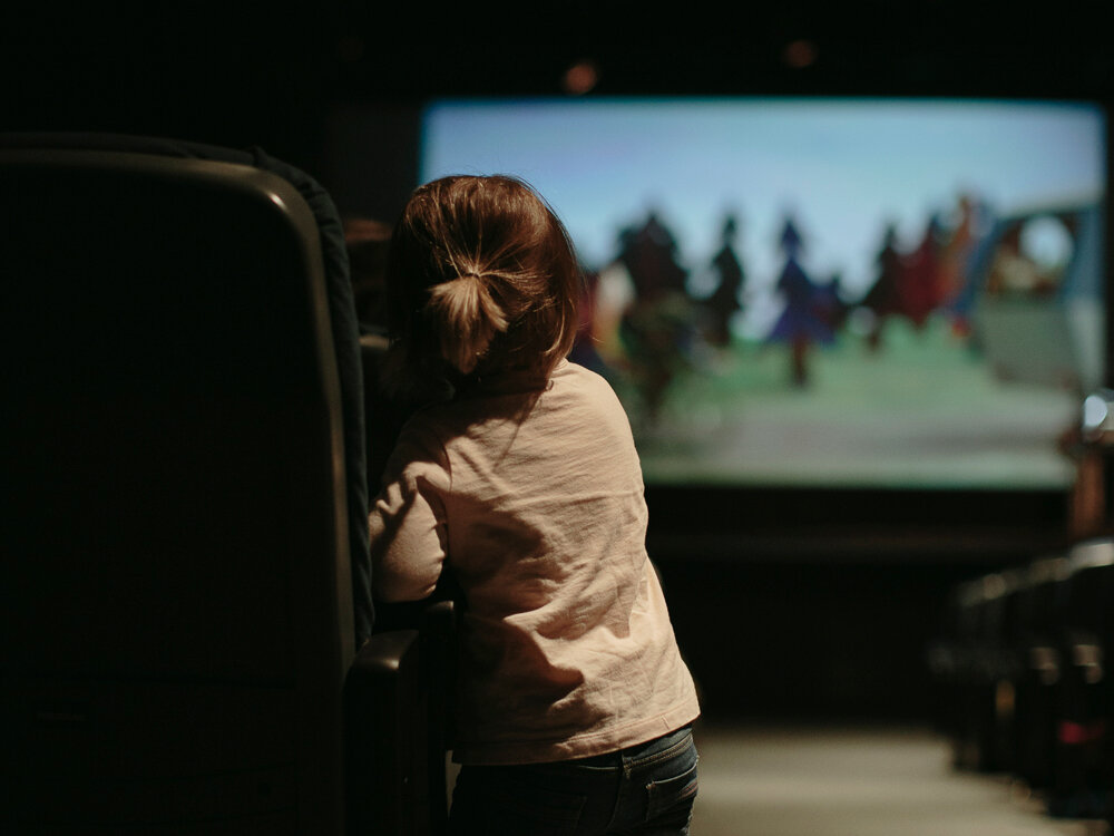 Little girl watching a movie